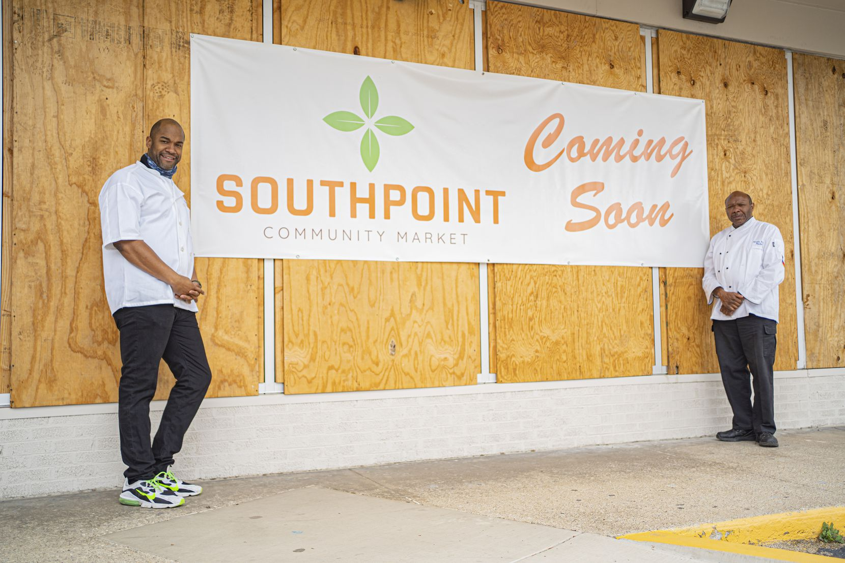 Cornerstone Church Pastor Chris Simmons (right) is opening a small non-profit grocery mart in the neighborhood. Donald Wesson can be seen to the left in this image taken on April 7,  2021 in Dallas, Texas.