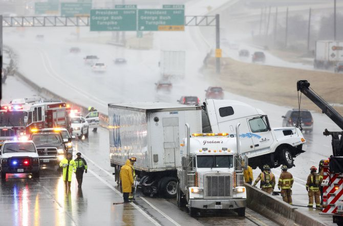 A jackknifed 18-wheeler straddled the concrete median of Interstate 35 in Carrollton after an accident with a pickup truck in the northbound lanes on Wednesday. The southbound lanes were eventually diverted onto the service road as wreckers cleared the accident.