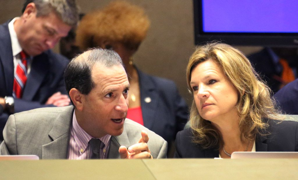 Dallas City Council members Lee Kleinman and Jennifer Staubach Gates conferred during a council session last month.