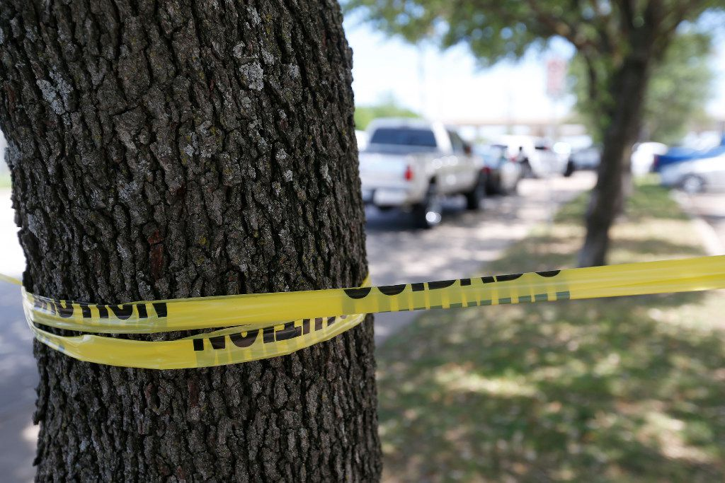 Police tape marks the shooting scene where police found two people dead inside an office building in Lake Highlands near the High Five in Dallas, Monday, April 24, 2017. (Jae S. Lee/The Dallas Morning News)