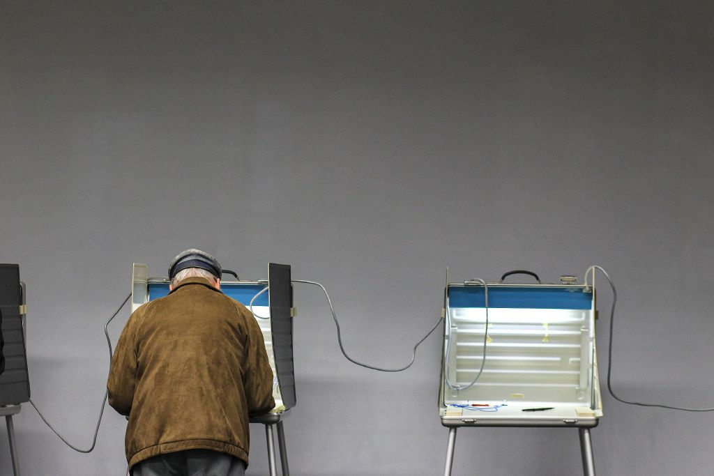 A voter cast his ballot on Election Day last Nov. 8 in Wellesley, Mass.