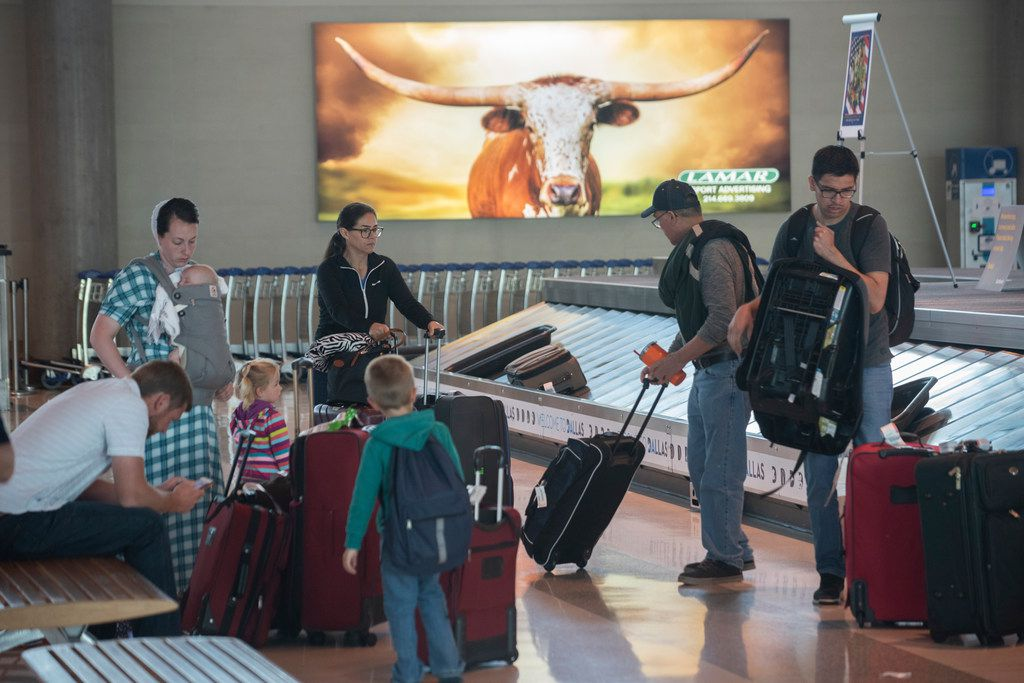 Airline passengers pickup their luggage at Dallas Love Field on Wednesday, May 23.