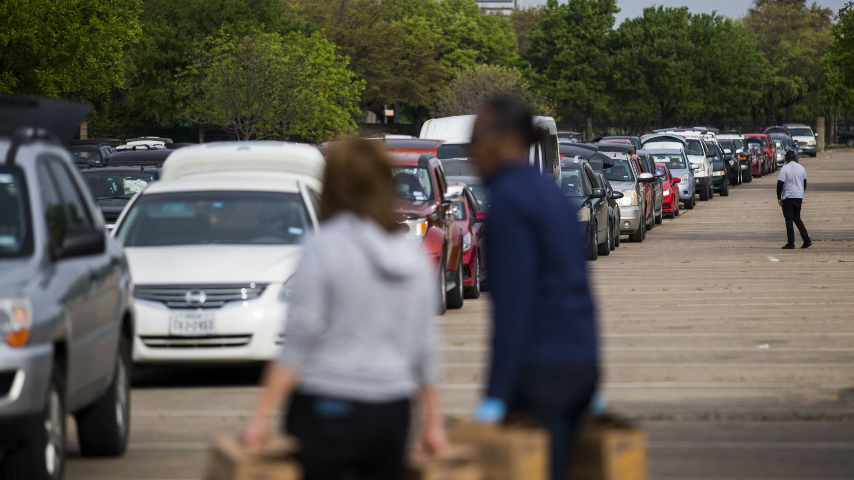 Hundreds of vehicles lined up to receive food during a distribution event put on by the North Texas Food Bank and several partner organizations at Fair Park on Thursday.
