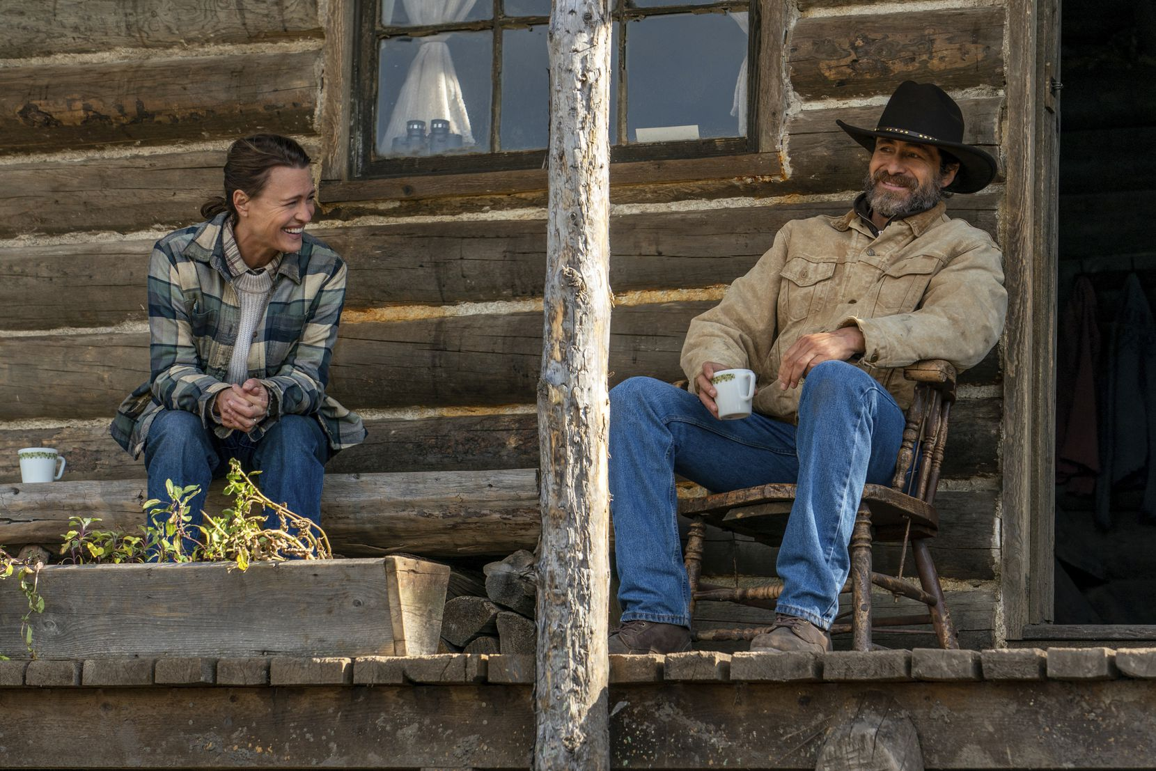 "This image released by Focus Features shows Demián Bichir, right, and Robin Wright in a scene from ""Land.""  (Daniel Power/Focus Features via AP)"