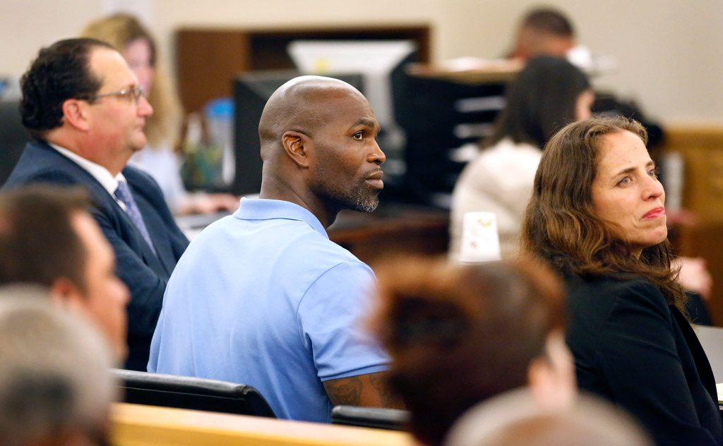 John Nolley Jr (center), flanked by his attorneys Reagan Wynn (left) and Nina Morrison, was declared innocent of murder Wednesday during a hearing in Fort Worth.