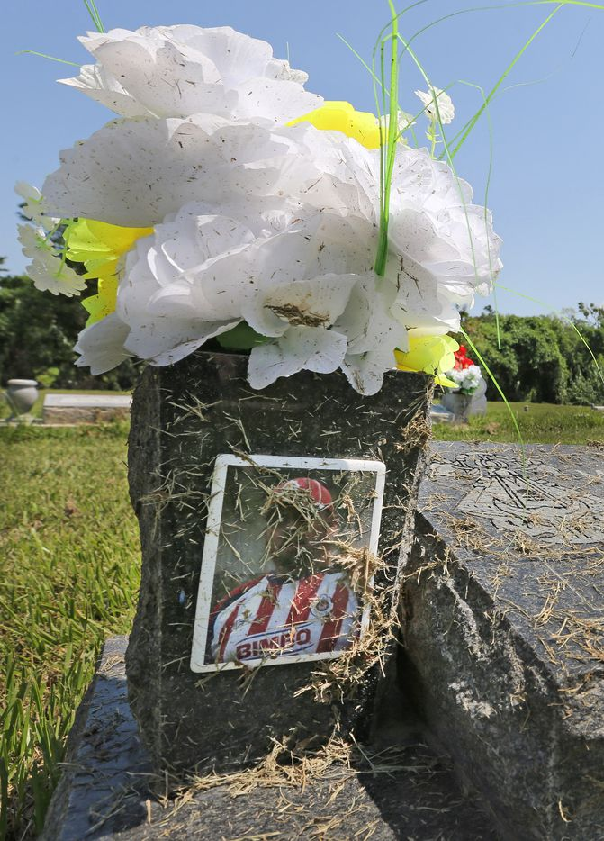 Debris from the floodwater is seen on a headstone at Hollywood Cemetery near downtown Houston on Sunday, September 10, 2017.