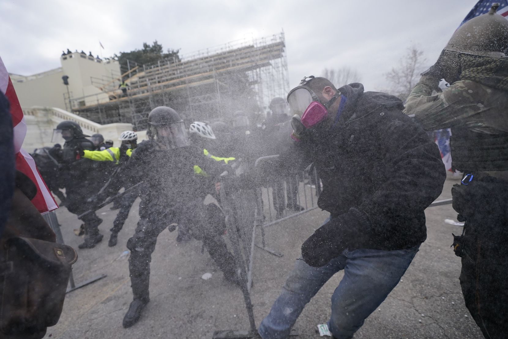 Trump supporters try to break through a police barrier, Wednesday, Jan. 6, 2021, at the Capitol in Washington. As Congress prepares to affirm President-elect Joe Biden's victory, thousands of people have gathered to show their support for President Donald Trump and his claims of election fraud.