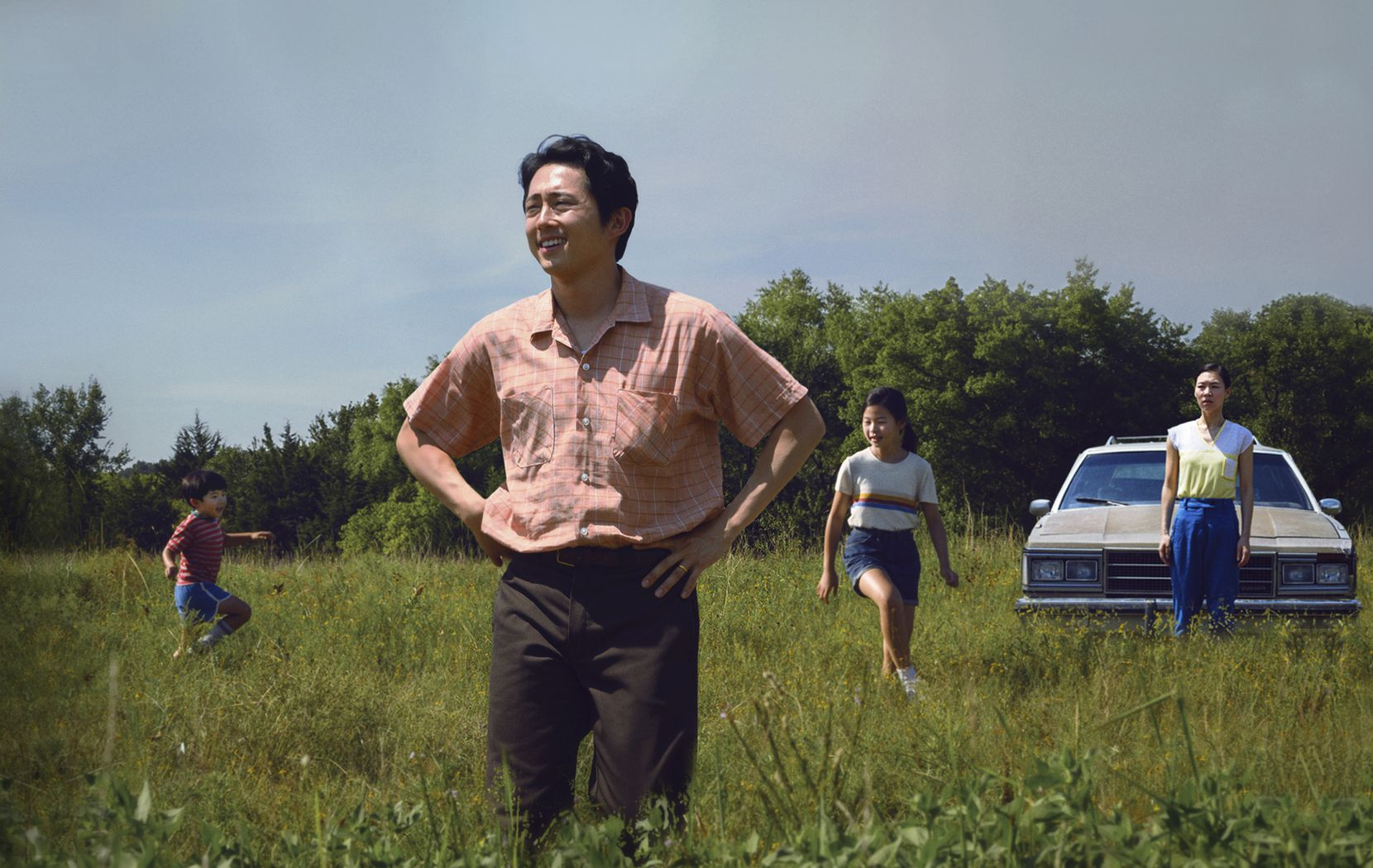 "Steven Yeun appears in a scene from ""Minari."""