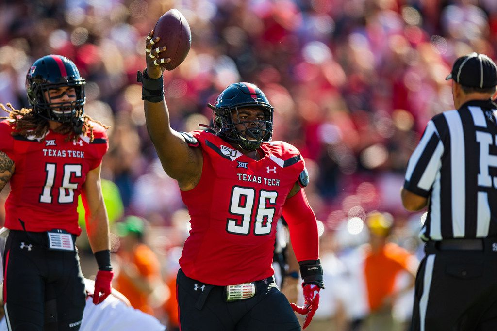 LUBBOCK, TEXAS - OCTOBER 05: Defensive tackle Broderick Washington Jr #96 of the Texas Tech Red Raiders holds up the ball after recovering a fumble during the first half of the college football game between the Texas Tech Red Raiders and the Oklahoma State Cowboys on October 05, 2019 at Jones AT&T Stadium in Lubbock, Texas. (Photo by John E. Moore III/Getty Images)