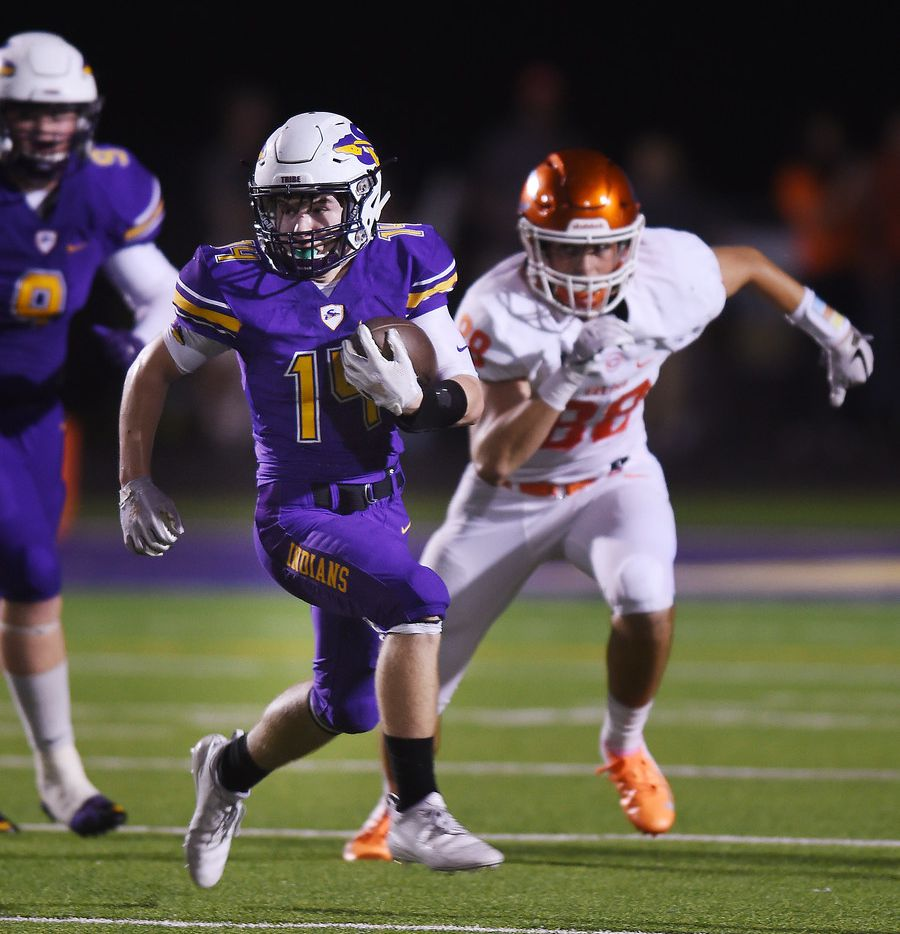 Sanger running back Colby Lewis (14) gains yardage against Celina in the first half of their game at Indian Stadium Friday, September 28, 2018, in Sanger, Tx. Photo by Al Key/For the DRC