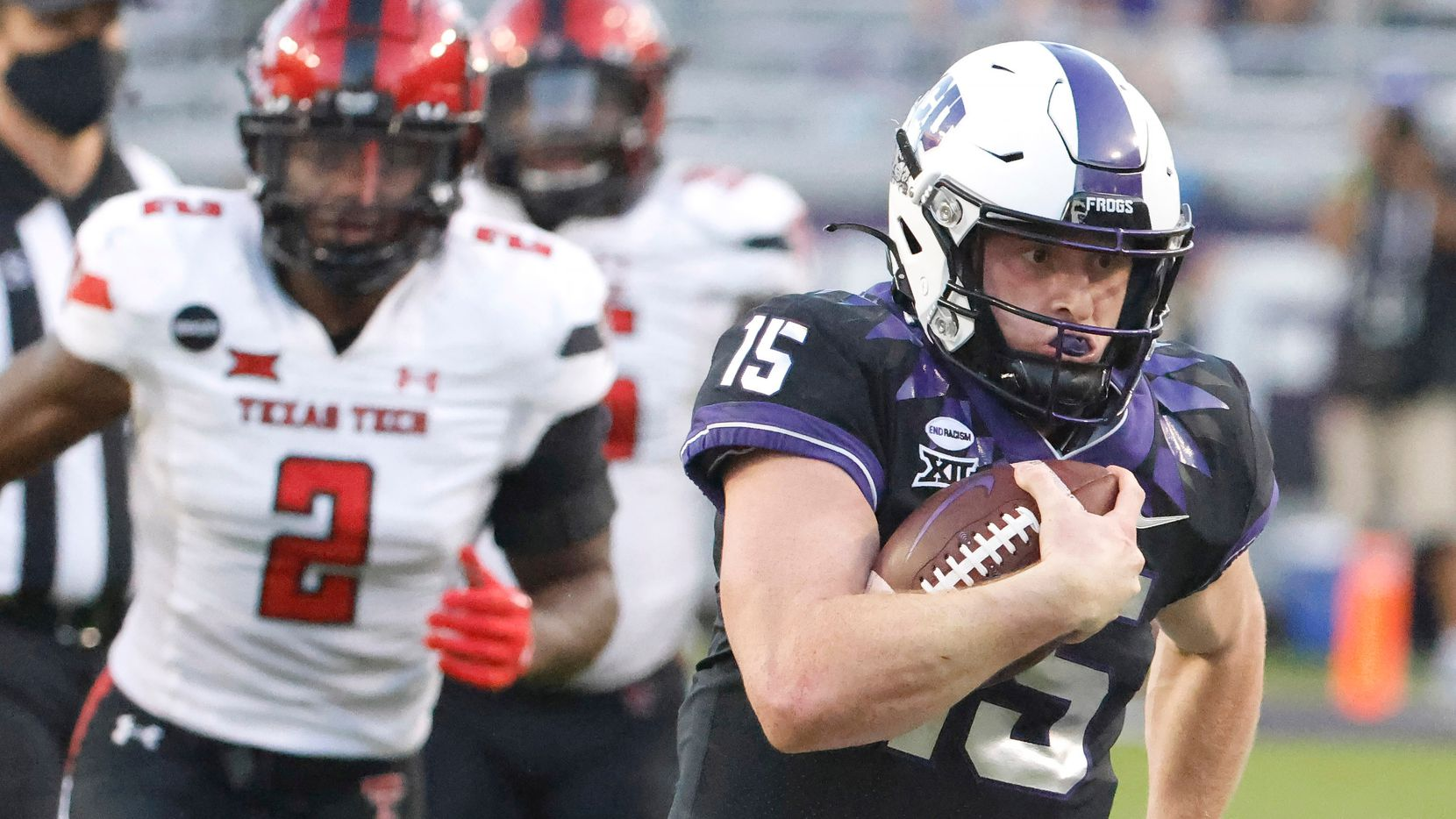 TCU quarterback Max Duggan (15) takes off past Texas Tech linebacker Brandon Bouyer-Randle (2) on a 48-yard touchdown run during the second half of an NCAA college football game Saturday, Nov. 7, 2020, in Fort Worth, Texas. TCU won 34-18.
