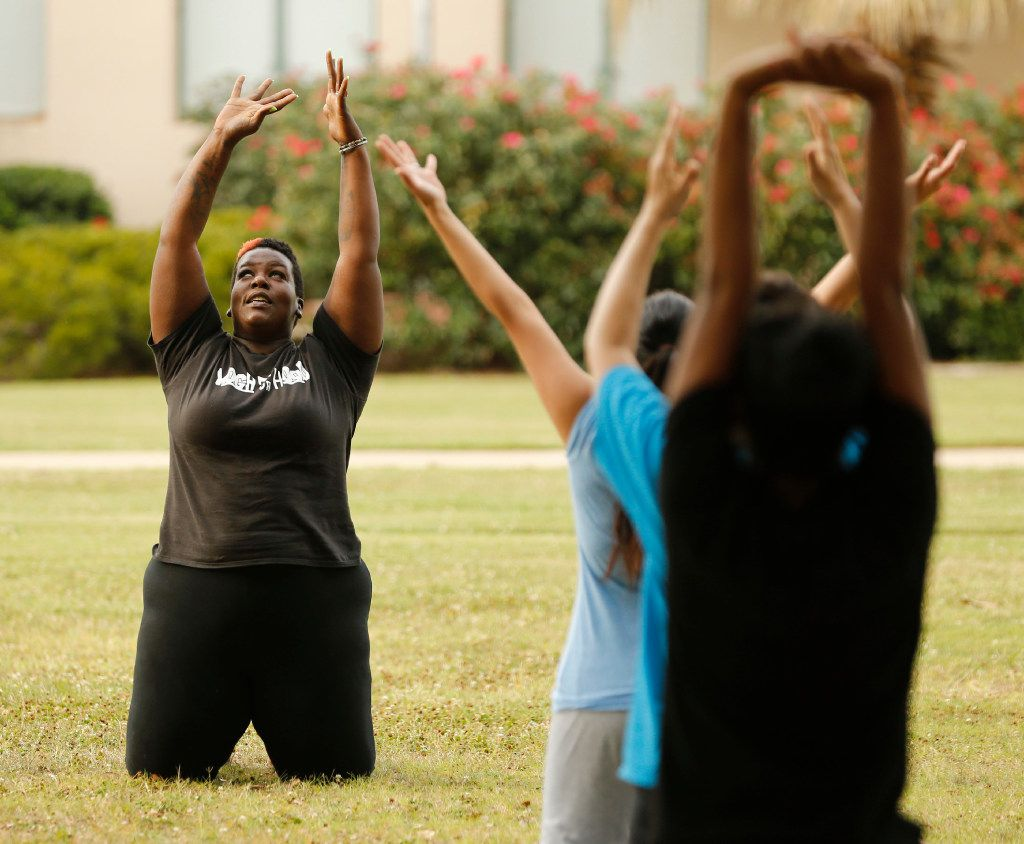 Instructor Ebony Smith leads a Yoga N Da Hood class at Fair Park in Dallas on Wednesday, May 31, 2017. (Vernon Bryant/The Dallas Morning News)