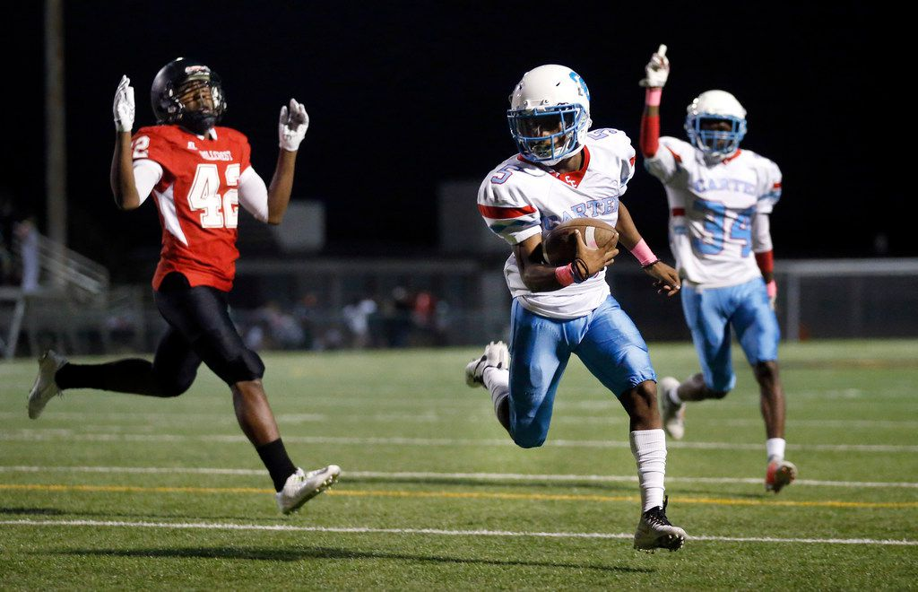 Carter High receiver Tailon Garrett (5) scores on a two-point conversion in the second quarter against Hillcrest High Michael Epps (42) in the second quarter at Hillcrest's Franklin Stadium in Dallas, Thursday, October 18, 2018. (Tom Fox/The Dallas Morning News)