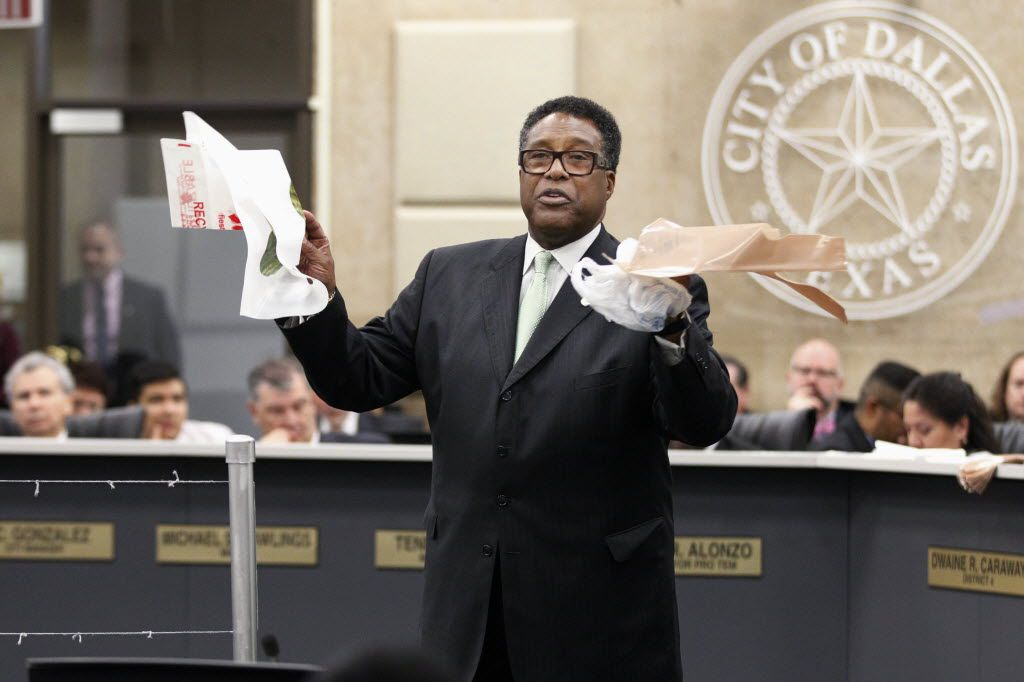 Dwaine Caraway tried Wednesday to convince his council colleagues to ban the bag altogether. Instead, they're now free again as of today. (Kye R. Lee/Staff photographer)