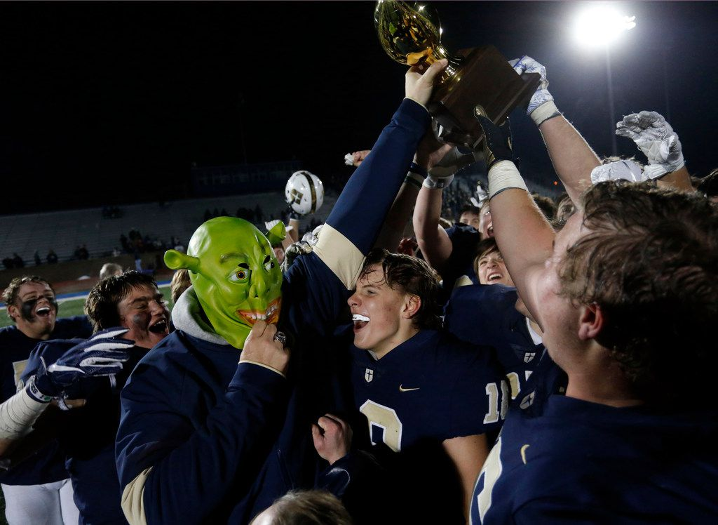 Jesuit coach Brando Hickman wears a Shrek mask and holds up the game trophy as the team celebrates after Jesuit's 45-14 win over Garland Lakeview in a high school football playoff game at Postell Stadium on Friday, November 15, 2019. The mask a a humorous reward for a player that recovered a turnover. (John F. Rhodes / Special Contributor)