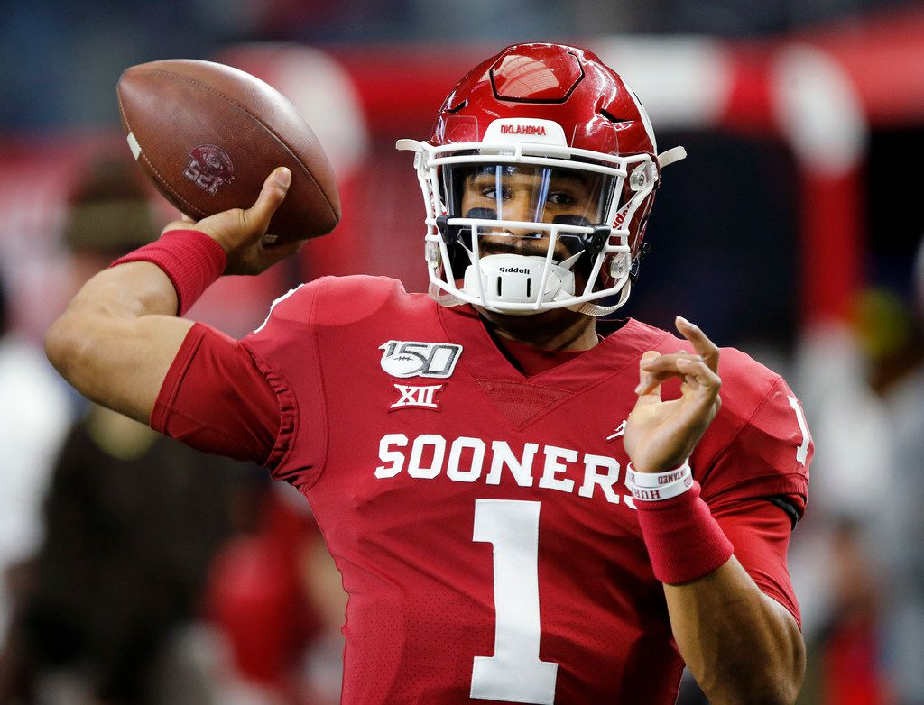Oklahoma Sooners quarterback Jalen Hurts (1)  warms up his arm before facing the Baylor Bears in the Big 12 Championship at AT&T Stadium in Arlington, Saturday, December 7, 2019. (Tom Fox/The Dallas Morning News)