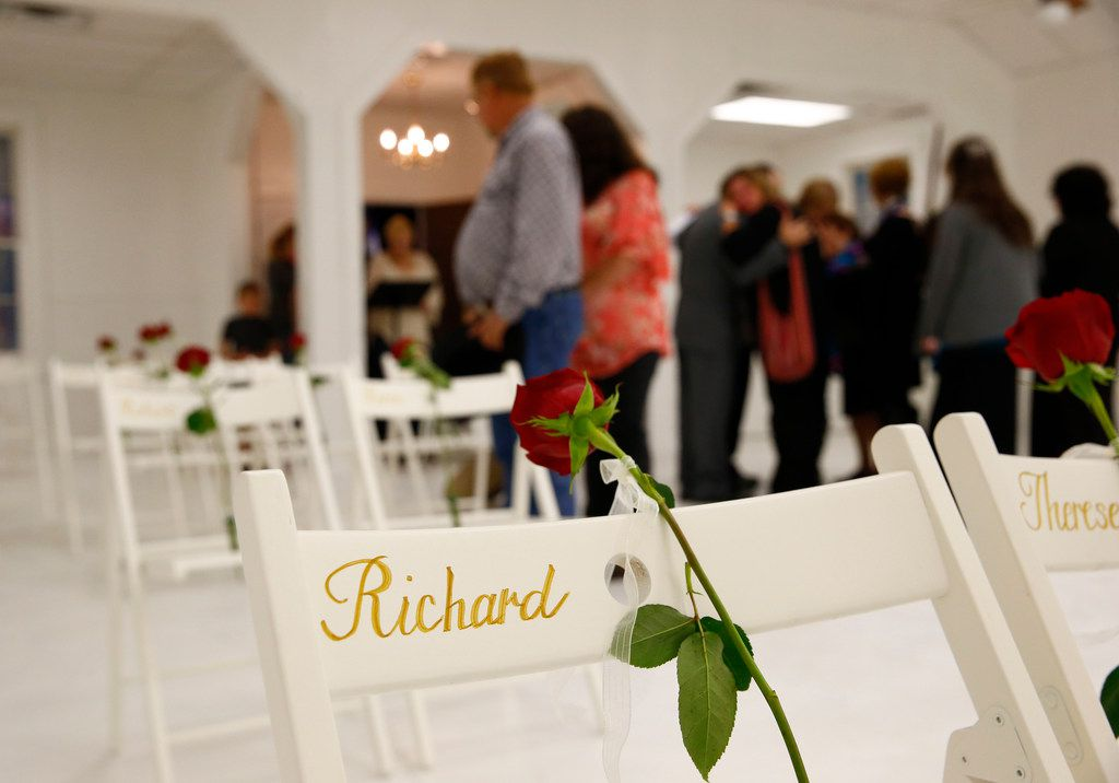 Visitors walk look at chairs and roses represented the slain as they are allowed into First Baptist Church to pay their respects a week after the shooting in Sutherland Springs, Texas on Nov. 12, 2017. The church was the site of a shooting that killed 26 and left 30 injured.