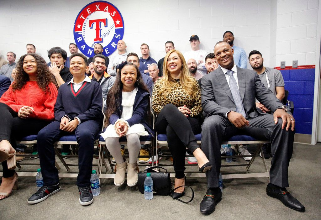 Former Texas Rangers third baseman Adrian Beltre (right), who announced his retirement from baseball last week, laughs at a tribute video alongside his wife Sandra Beltre and his kids (from left) Cassie, AJ and Camila during a news conference at Globe Life Park in Arlington, Texas, Friday, November 30, 2018. Beltre played 21 seasons (1998-2018) in the Major Leagues, the last eight with the Rangers (2011-18). (Tom Fox/The Dallas Morning News)