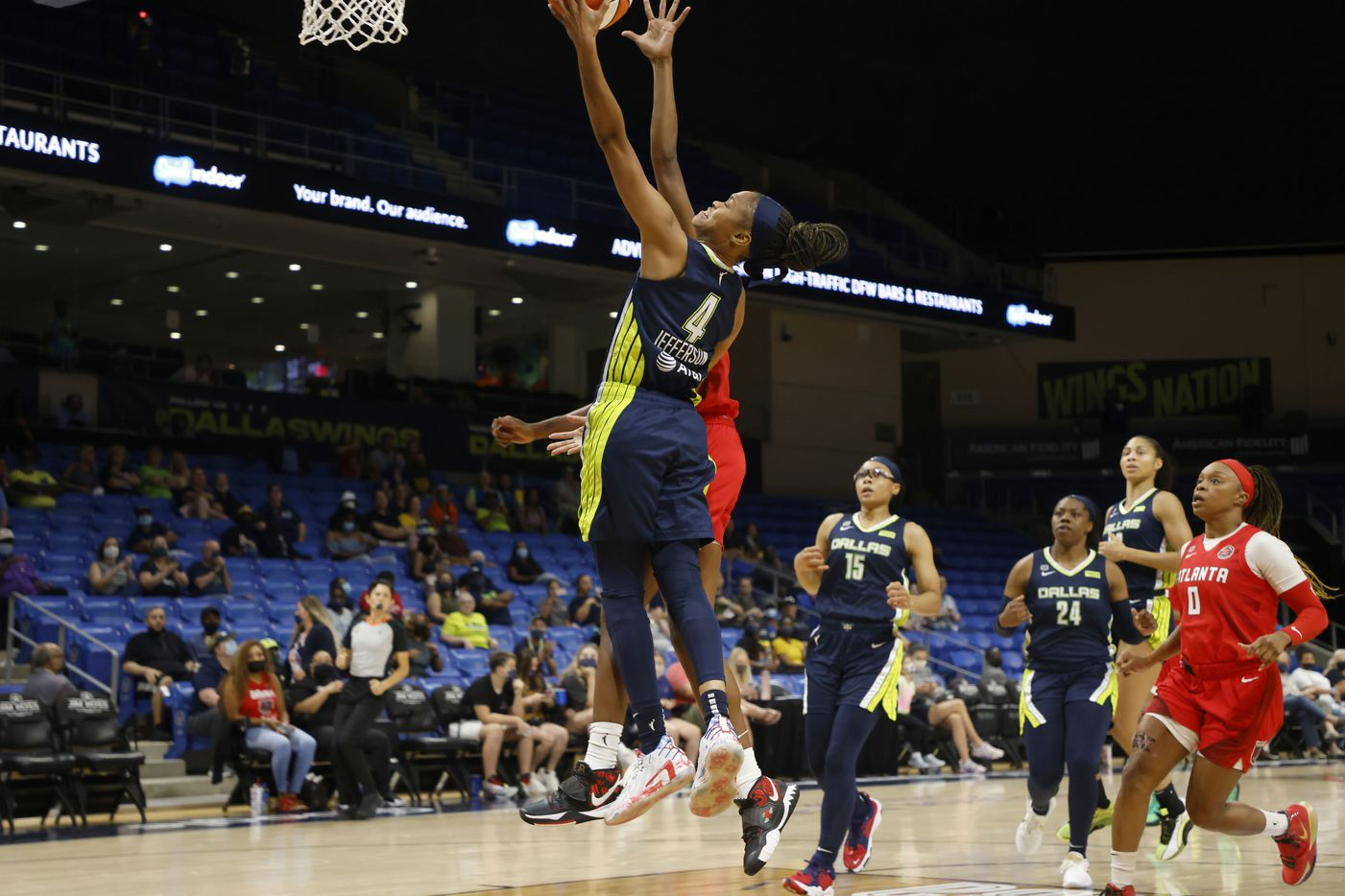 Dallas Wings guard Moriah Jefferson (4) makes a layup in front of Atlanta Dream guard Tiffany Hayes (15) during the first half of their WNBA basketball game in Arlington, Texas on Sept. 2, 2021. (Michael Ainsworth/Special Contributor)
