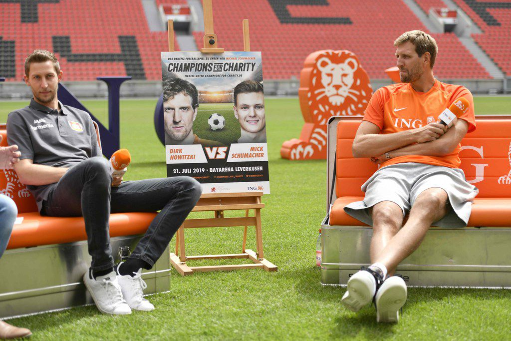 "German basketball legend Dirk Nowitzki (R) and former Bayer Leverkusen football player Stefan Kiessling attemd a news conference to promote the ""Champions for Charity"" event in Leverkusen, western Germany on Juli 3, 2019. - Nowitzki plays in the third edition of the charity event ""Champions for Charity"" taking place on July 21, 2019 in the BayArena stadium of Leverkusen against a team around Mick Schumacher, son of German Formula One legend Michael Schumacher, which will benefit the ""Dirk Nowitzki Foundation"" and the ""Keep Fighting"" initiative of the Schumacher family. (Photo by Ina FASSBENDER / AFP)INA FASSBENDER/AFP/Getty Images"