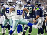Cowboys defensive tackle Antwaun Woods (99) celebrates after sacking Seattle Seahawks quarterback Russell Wilson (3) during the first half of an NFL wild-card playoff football game at AT&T Stadium on Saturday, Jan. 5, 2019, in Arlington.