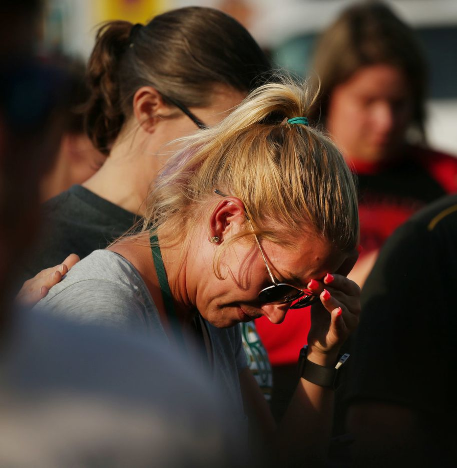 A mourner before a vigil along Avenue M and Highway 6 after the shooting at Santa Fe High School.