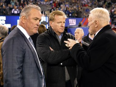Dallas Cowboys owner Jerry Jones (left) visits with NFL Commissioner Roger Goodell (center) along with his son,  Executive Vice President/COO  Stephen Jones before their game with the New York Giants at MetLife Stadium in East Rutherford, New Jersey, Sunday, November 23, 2014.