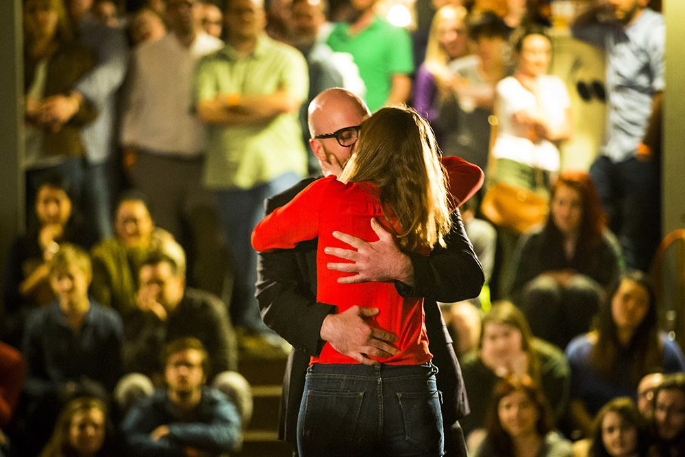 """Brandon Potter, as Benedick,  kisses Katherine Bourne, as Beatrice, during a performance of """"Much Ado About Nothing."""""""