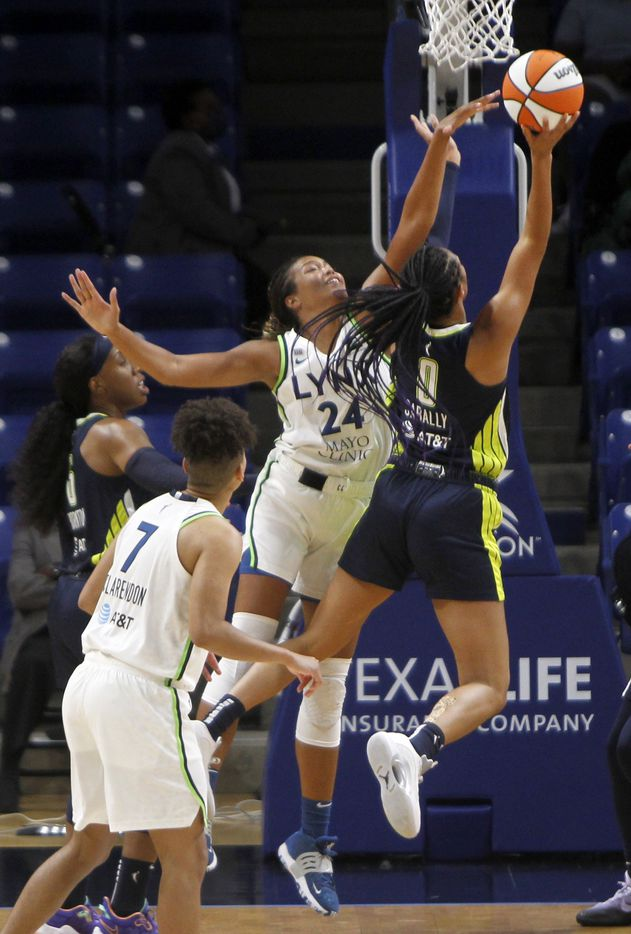 Dallas Wings forward Satou Sabally (0) drives to the basket and draws a foul by Minnesota Lynx forward Napheesa Collier (24) during 2nd quarter action. The two teams played their WNBA game at College Park Center on the campus of the University of Arlington on June 17, 2021(Steve Hamm/ Special Contributor)