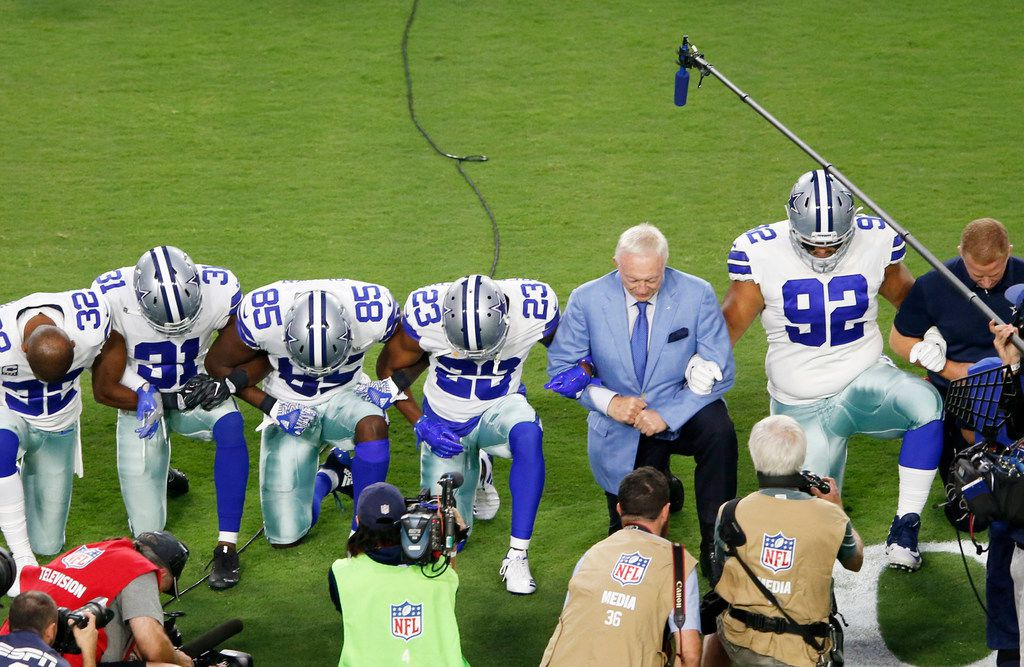 Dallas Cowboys owner and general manager Jerry Jones and team take a knee before the singing of the National Anthem prior to the start of a game against the Arizona Cardinals at University of Phoenix Stadium in Glendale, Arizona on Monday, September 25, 2017. (Vernon Bryant/The Dallas Morning News)