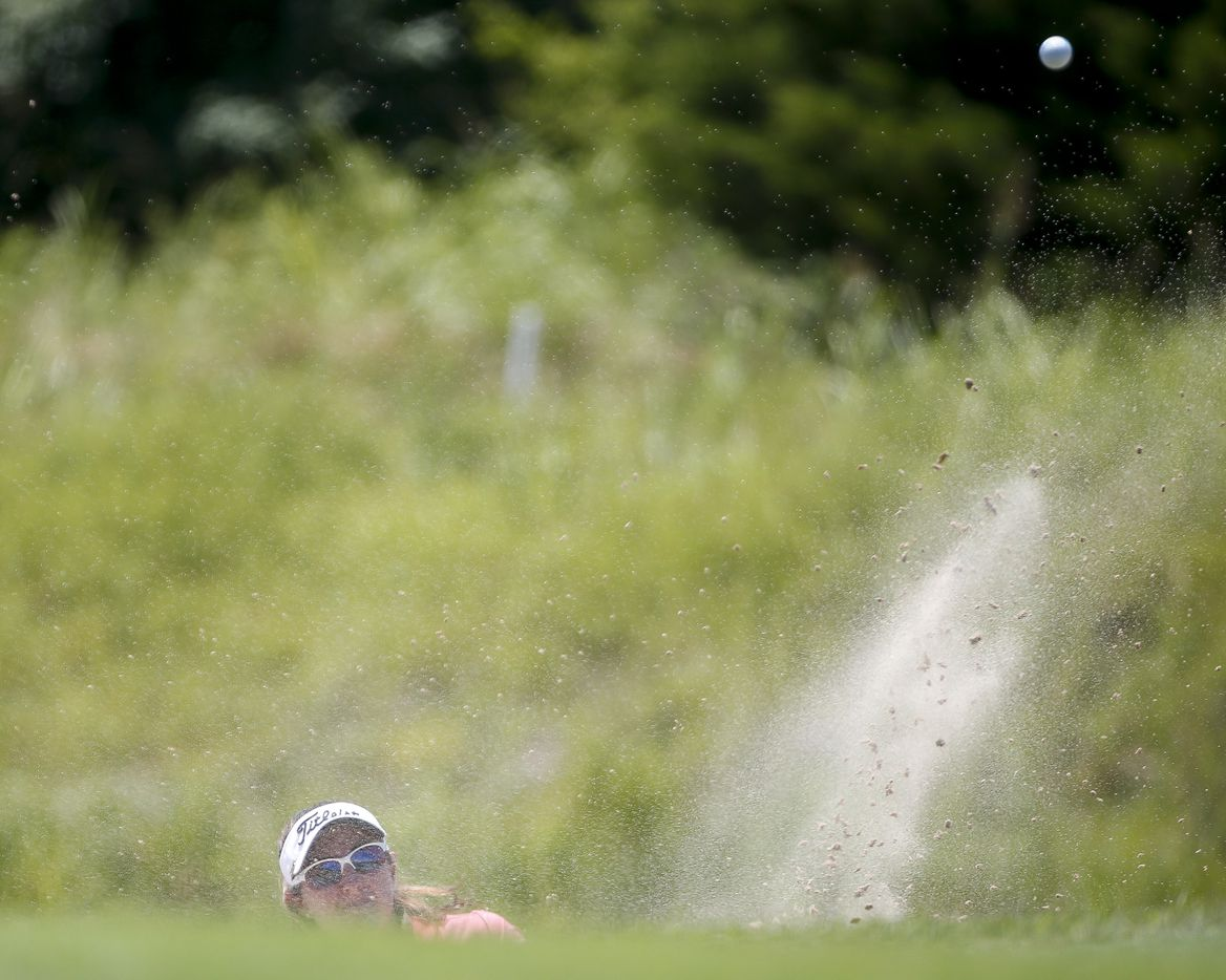 Professional golfer Amelia Lewis plays a shot out of the 17th green side bunker during round one of the LPGA VOA Classic on Thursday, July 1, 2021, in The Colony, Texas. (Elias Valverde II/The Dallas Morning News)