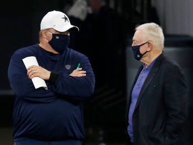 FILE — Dallas Cowboys head coach Mike McCarthy talks to Dallas Cowboys owner and general manager Jerry Jones on the sidelines in practice during training camp at the Dallas Cowboys headquarters at The Star in Frisco, Texas on Monday, August 31, 2020.