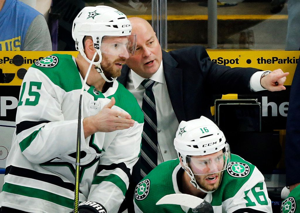Dallas Stars head coach Jim Montgomery and left wing Blake Comeau (15) compare notes on the bench during the third period at the Enterprise Center in St. Louis, Tuesday, May 7, 2019. The teams were playing in the Western Conference Second Round Game 7 of the 2019 NHL Stanley Cup Playoffs. (Tom Fox/The Dallas Morning News)