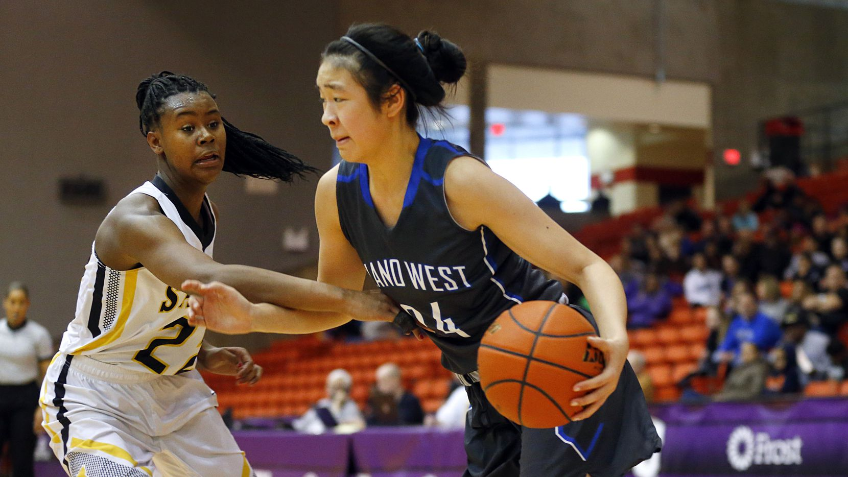 Plano West Natalie Chou (24) dribbles past Amarillo's Sidney Tinner (22) in the second half of the Class 6A Region I semifinal at Wilkerson-Greines Athletic Center in Fort Worth, Saturday, February 28, 2015. (Tom Fox/The Dallas Morning News)