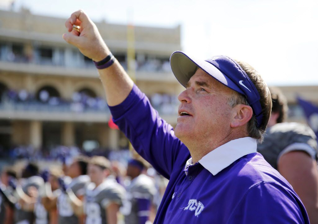TCU head coach Gary Patterson sings the school fight song after the game against the Texas Longhorns at Amon G. Carter Stadium in Fort Worth on Oct. 3, 2015.