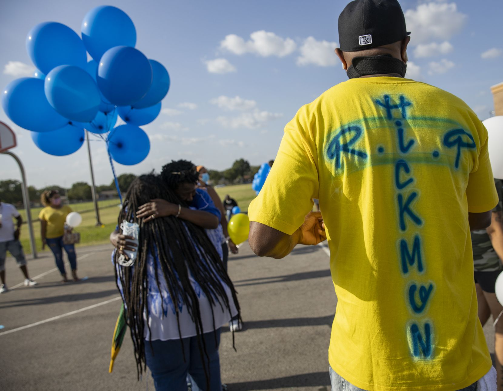 Colleagues, students and community members gather before a balloon release ceremony honoring late Dallas ISD coach and teacher Jennifer Hickmon on July 17, 2020, in Pleasant Grove in Dallas. The Young Men's Leadership Academy at Fred Florence Middle School teacher was found slain earlier this week in her southeast Oak Cliff home.
