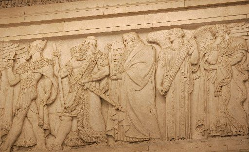 Moses carrying the Ten Commandments is among the lawmakers and leaders depicted on friezes in the courtroom of the U.S. Supreme Court. Depicted on this portion of the frieze are Menes, the first king of the first dynasty of ancient Egypt; Hammurabi of Babylon who wrote one of the first legal codes, Moses; Solomon, King of Israel and renowned judge; and Lycurgus, a legislator of Sparta.