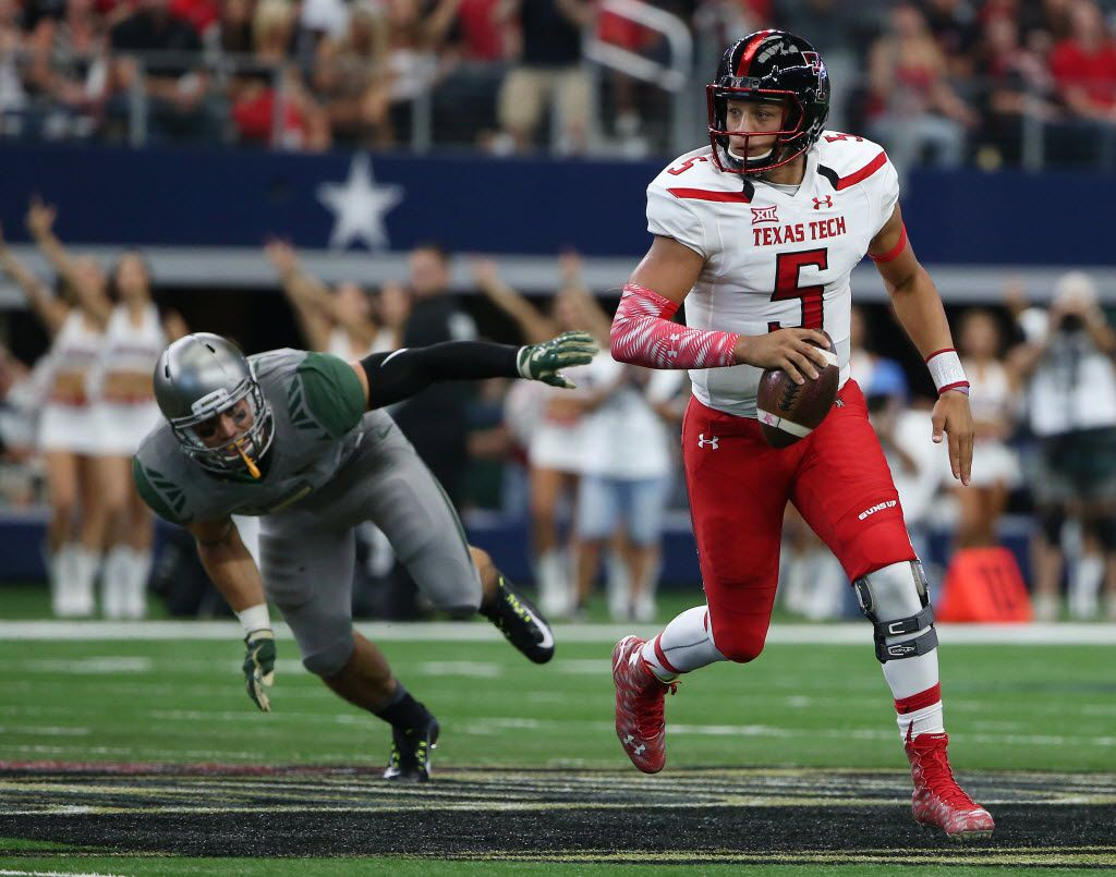 Texas Tech Red Raiders quarterback Patrick Mahomes (5) runs with the ball in the first half during an NCAA football game between Texas Tech and Baylor at AT&T Stadium in Arlington, Texas Saturday October 3, 2015. (Andy Jacobsohn/The Dallas Morning News)