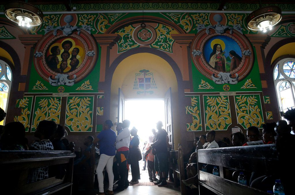 People stand in the church during the funeral of Botham Shem Jean at Minor Basilica of the Immaculate Conception in Castries, St. Lucia on Monday, September 24, 2018. Jean was shot and killed in his apartment by off duty Dallas police officer Amber Guyger. (Vernon Bryant/The Dallas Morning News)