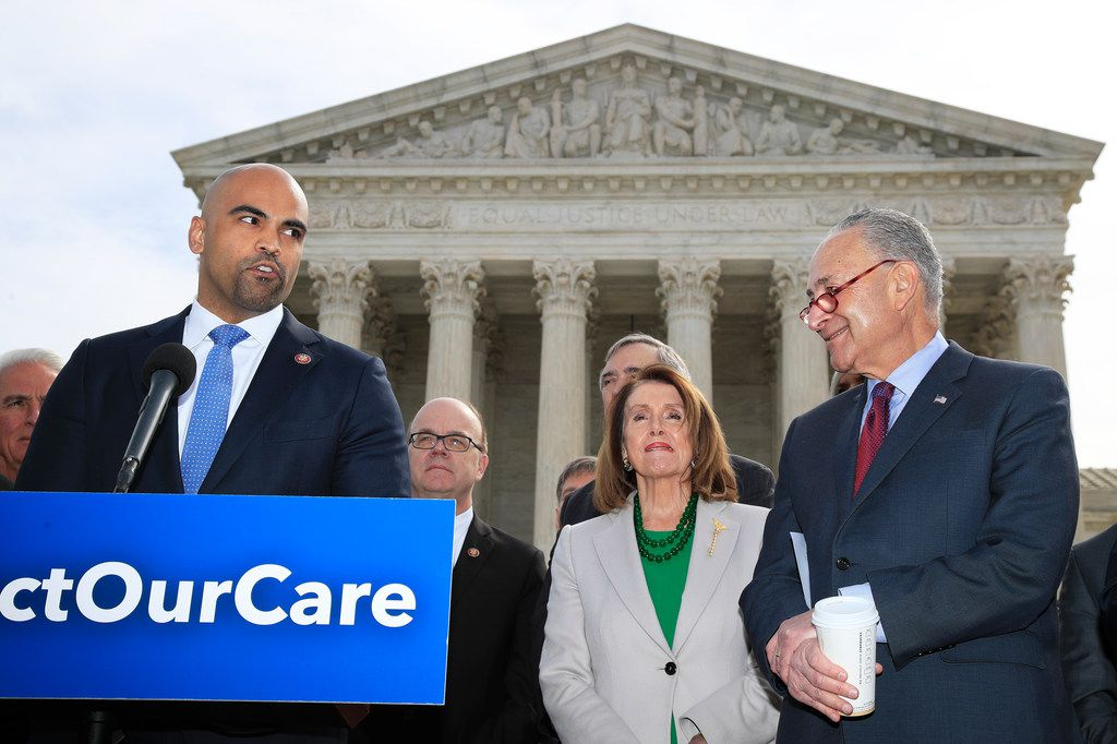 Rep. Colin Allred, D-Texas, from left, with House Speaker Nancy Pelosi of California and Senate Minority Leader Chuck Schumer of New York, speaks outside the U.S. Supreme Court in Washington, Tuesday, April 2, 2019. (AP Photo/Manuel Balce Ceneta)