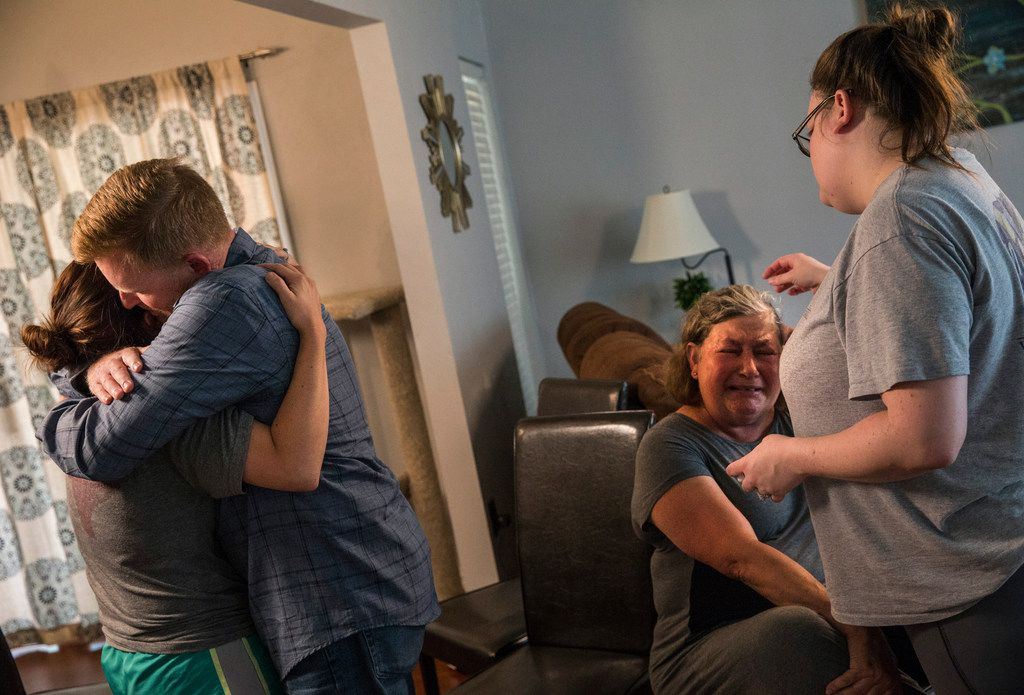 Tamara Steel, left, hugs her stepfather Paul Clyde while Kristina Shannon, right, embraces her mother Nubia Brede Solis the family of Brian Clyde met with The Dallas Morning News on Wednesday, June 19, 2019, in Plano, Texas.  Brian Clyde, 22, opened fire on the Earle Cabell Federal Building and was shot by officers and died in a downtown Dallas parking lot.