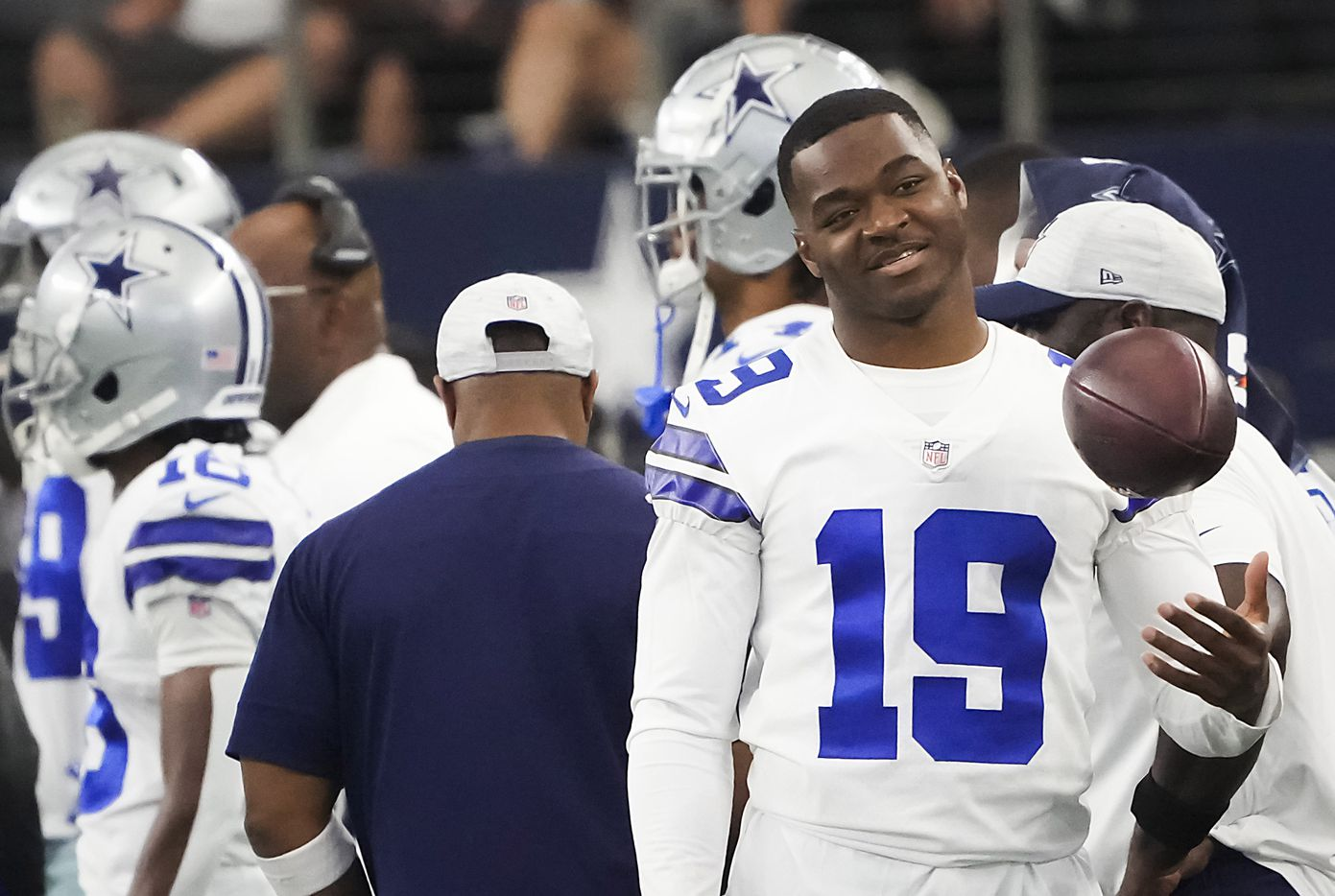 Dallas Cowboys wide receiver Amari Cooper tosses a ball on the sidelines during the first half of a preseason NFL football game against the Jacksonville Jaguars at AT&T Stadium on Sunday, Aug. 29, 2021, in Arlington. (Smiley N. Pool/The Dallas Morning News)