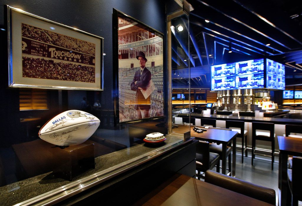 Dallas Cowboys history is on display in the cabinets of the main dining area of the Stadium Club restaurant inside AT&T Stadium in Arlington. (Tom Fox/Staff Photographer)