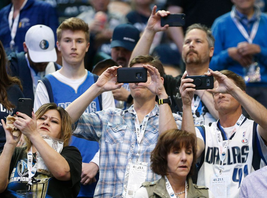 Dallas Mavericks fans use there phones to capture Dallas Mavericks forward Dirk Nowitzki (41) as he warms up in a game against the Phoenix Suns at American Airlines Center in Dallas on Tuesday, April 9, 2019. (Vernon Bryant/The Dallas Morning News)