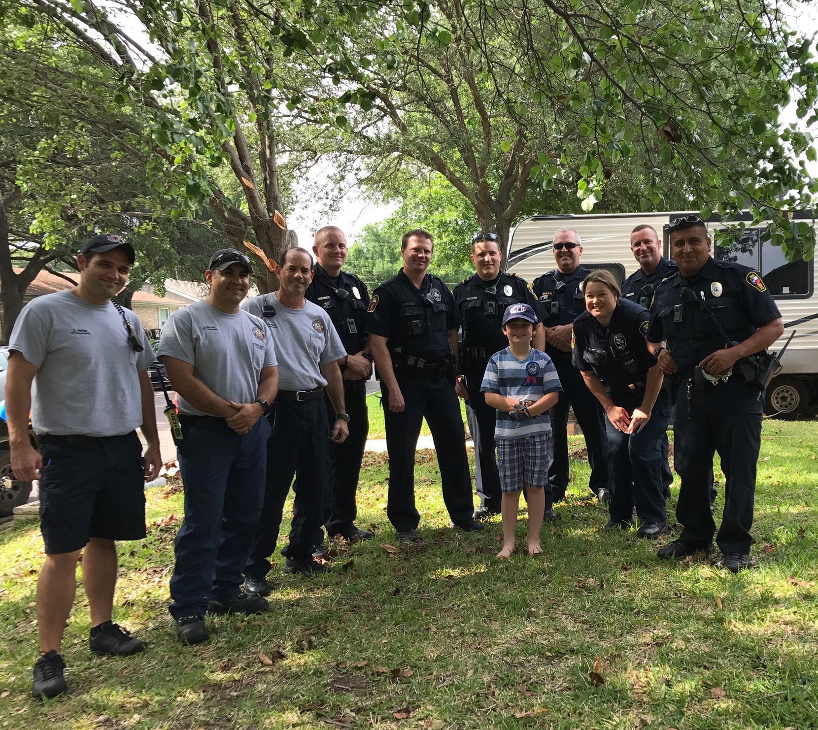 Graham is surrounded by Hurst police officers and firefighters who celebrated his birthday with him.