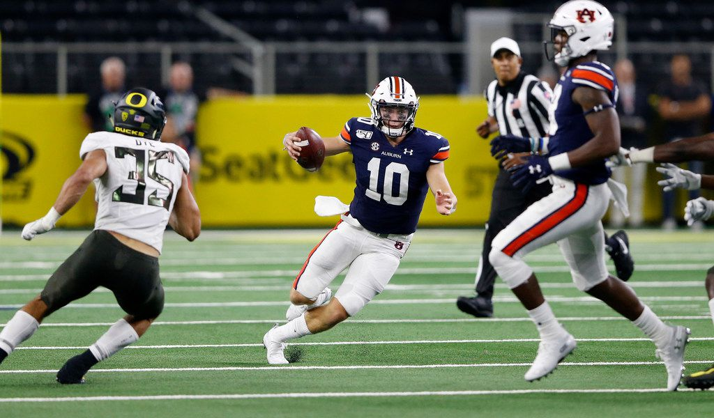 Auburn Tigers quarterback Bo Nix (10) rushes up the field for a first down on a fourth down and 3 yard play on the final drive against the Oregon Ducks during the fourth quarter of play at AT&T Stadium in Arlington, Texas on Friday, August 31, 2019. Auburn Tigers defeated Oregon Ducks 27-21.