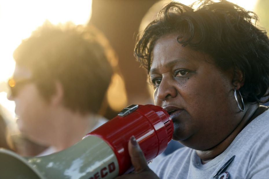 FILE - Collette Flanagan, founder of Mothers Against Police Brutality, speaks during a vigil for Christian Taylor on Monday, Aug. 10, 2015, in Arlington.