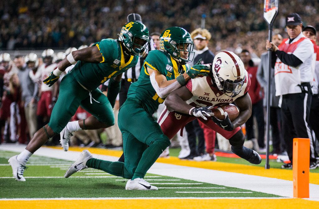 Baylor Bears cornerback Grayland Arnold (1) and cornerback Raleigh Texada (13) push Oklahoma Sooners running back Rhamondre Stevenson (29) out of bounds just short of the goal line during the fourth quarter of an NCAA football game between Baylor University and Oklahoma University on Saturday, November 16, 2019 at McLane Stadium in Waco, Texas. (Ashley Landis/The Dallas Morning News)
