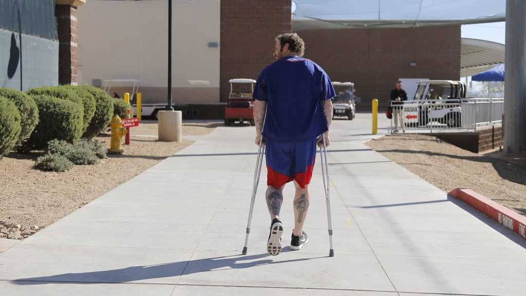 Texas Rangers' Josh Hamilton walks back after he talked about his knee injury and stem cell therapy, at the baseball team's spring training facility in Surprise, Ariz., Wednesday, February 24, 2016. Hamilton is expected to miss the first month of the season. (Rodger Mallison/Fort Worth Star-Telegram via AP)