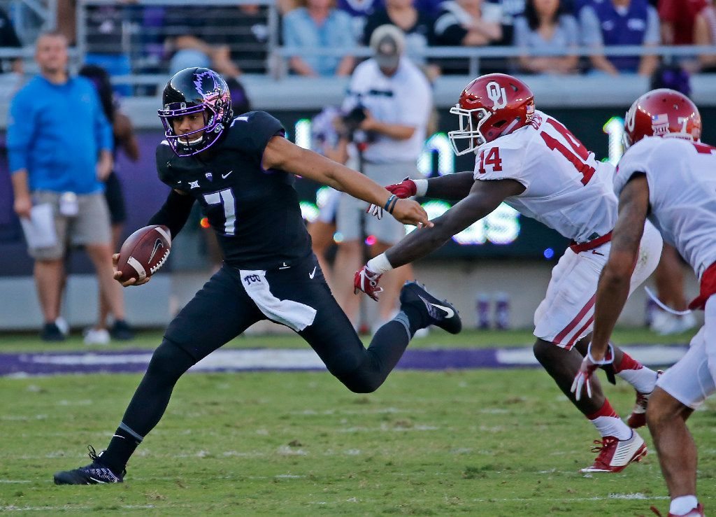 TCU quarterback Kenny Hill (7) is chased by Oklahoma linebacker Emmanuel Beal (14) during the second quarter at Amon G. Carter Stadium in Fort Worth, Texas, Saturday, Oct. 1, 2016. (Jae S. Lee/The Dallas Morning News)